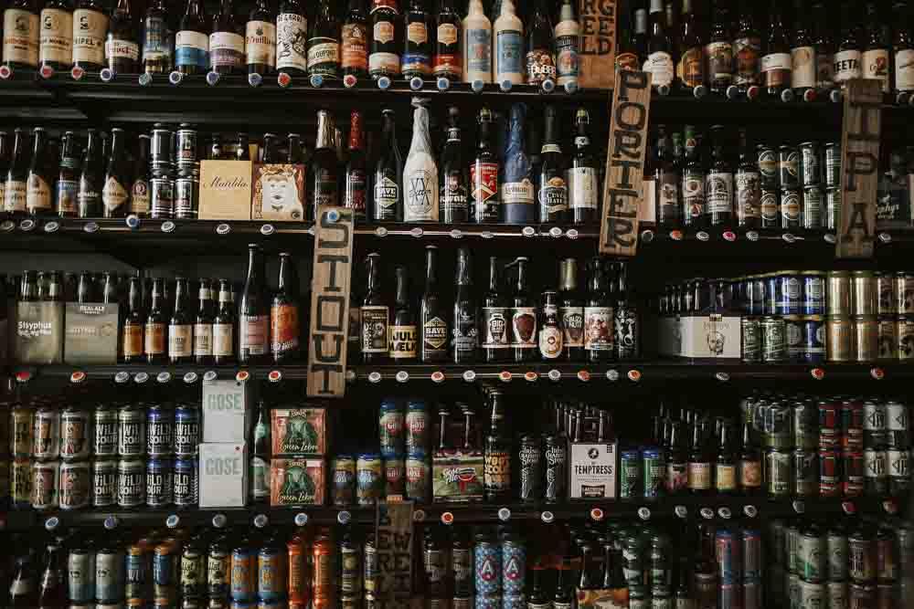 Frontal image of shelves full of beer bottles